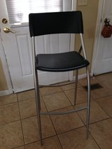 Black leather bar stool in Schaumburg, Illinois