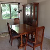 Table and China cabinet in Oswego, Illinois