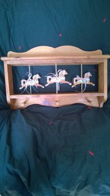 Shelf with Carousel Horses in Plainfield, Illinois