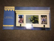 Wall mirror with frames and hooks in Joliet, Illinois
