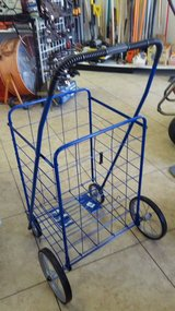 Blue shopping cart.  folds up. sturdy but lightweight in Yucca Valley, California