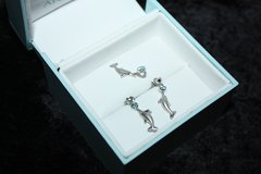 Sterling Silver Dolphin Earrings/ Necklace with Blue Topaz and .01 TW Diamonds by Artistica in Ramstein, Germany