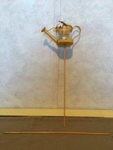 Yellow Watering Can Yard Stake Decor in Yorkville, Illinois