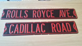 Cadillac and Rolls Royce metal signs in Aurora, Illinois