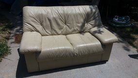 Cream color leather loveseat in Fort Riley, Kansas