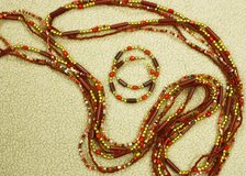 Long Red Orange Necklace and Earring Set in Houston, Texas