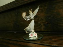 Glass baron angel with bible figurine in Cleveland, Texas