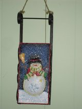 snowman on blue sled wall hanging in Glendale Heights, Illinois