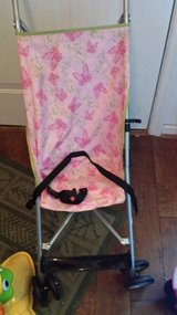 Pink foldable stroller and high chair in Fort Benning, Georgia