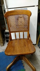 Nice Solid Wood Swivel Rolling Desk Chair in Camp Lejeune, North Carolina