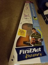 Acoustic aguitar by first act new in Joliet, Illinois