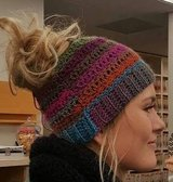 Crocheted messy bun & pigtail beanies in Lawton, Oklahoma