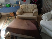 overstuffedd beige chair and ottoman in Wilmington, North Carolina