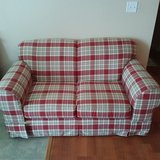 Great condition fabric love seat in Byron, Georgia