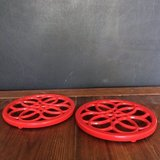 2 Red Enameled Cast Iron Trivets in Kingwood, Texas