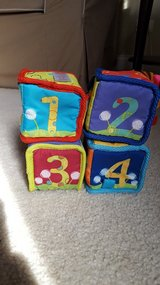 Bright Starts rattle and bell soft baby blocks in Aurora, Illinois