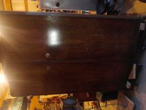 Old dresser cabinet with a shelf in Fort Campbell, Kentucky