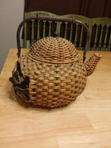 Iron and wicker teapot in Yorkville, Illinois