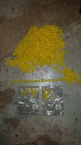 54 feet of yellow plactic chain and 2 unopened 10 packs of yellow plastic 1 1/2 inch S-hooks in Lockport, Illinois