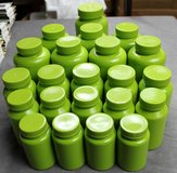 Green Plastic Jars with Screw Tops in Kingwood, Texas