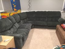 Cloth Sectional with 2 recliners and pull out bed in Naperville, Illinois