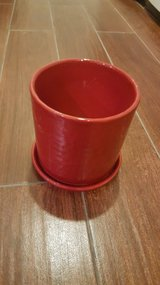 Crate and Barrel Deep Red Planter Pot and base in Chicago, Illinois
