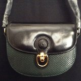 Women saddleback crossbody 100%Vegan leather black and deep olive green in Yucca Valley, California