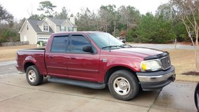 '03 Ford F-150 Aftermarket dual exhaust in Camp Lejeune, North Carolina