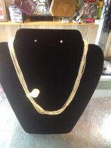 Several strands of silver necklace in Fort Campbell, Kentucky