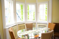 Large oval glass top dining room table in Ramstein, Germany