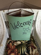 Shabby chic metal basket in Chicago, Illinois