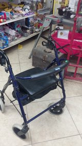 Walker with seat.  Works great in Yucca Valley, California