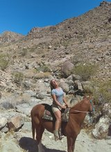 Horseback trail rides into the sunset in Yucca Valley, California