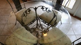 Iron And Glass Round Dining Table With Four Chairs In Jacksonville Florida