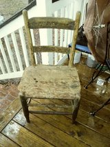 Old ladder back rush chair/pruitts grocery in Beaufort, South Carolina