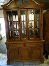 Solid wood 4 poster bed $350 & 4 large solid wood china cabinets $75.00 each in Rolla, Missouri