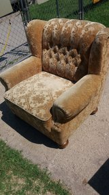 Gold chair on rollers in Fort Riley, Kansas