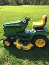2 John Deere 345 tractors 1 ran last year 1 ran this year 20hp. KAW. motors ps hydraulic lift de... in Naperville, Illinois