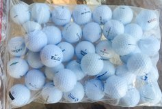 100 assorted various brand names used golf balls near mint condition in Aurora, Illinois