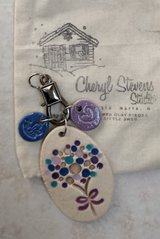 Clay necklace with charms, brand new with original bag in Plainfield, Illinois
