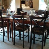Long formal farm style table (is actually two tables) and 4-8 chairs in Tacoma, Washington