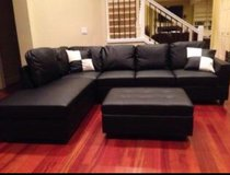 Black Leather Sectional couch incl. Ottoman in Tacoma, Washington