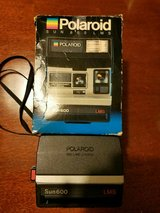 2 black and gray Polaroids Sun 600, 1 with box in Pearland, Texas