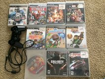 PS3 games and controller in Camp Pendleton, California