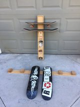 Wall mounted skateboard and deck racks (skateboards not included) in Camp Pendleton, California