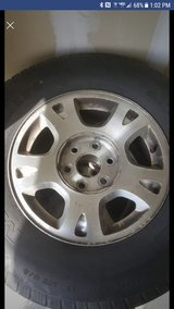 Stock chevy rims with caps and tires in Camp Pendleton, California