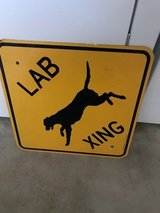 Lab crossing metal sign in Camp Pendleton, California