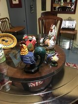 Collection of roosters and chickens and wall hangings in Cleveland, Texas