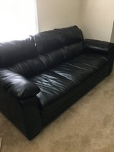 Black full size couch in Camp Lejeune, North Carolina