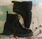 Divided boots by H&M in Las Vegas, Nevada